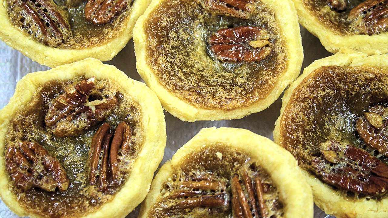 close-up of butter tarts with pecans