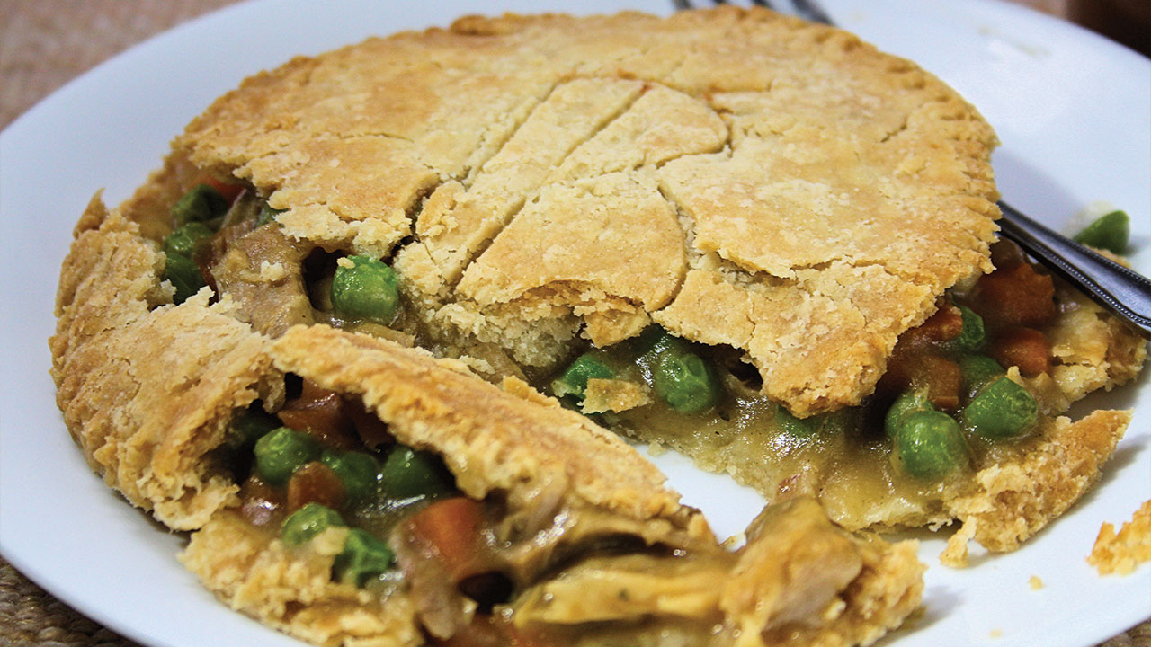 close up of a beef pot pie on a plate
