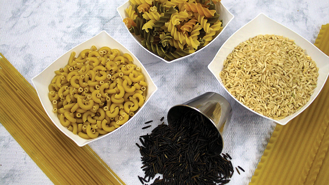 bowls filled with various types of dried pasta and rice